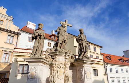Statue of the Holy Savior with Cosmas and Damian on Charles Bridge, Prague, Czech Republic  photo