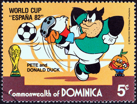 black pete: DOMINICA - CIRCA 1982  A stamp printed in Dominica from the  World Cup Football Championship, Spain  Walt Disney Cartoon Characters   issue shows Pete and Donald Duck playing, circa 1982