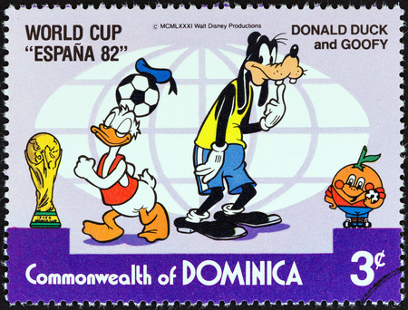 donald: DOMINICA - CIRCA 1982  A stamp printed in Dominica from the  World Cup Football Championship, Spain  Walt Disney Cartoon Characters   issue shows Donald Duck and Goofy looking for ball, circa 1982   Editorial
