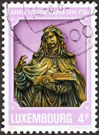 LUXEMBOURG - CIRCA 1982  A stamp printed in Luxembourg shows St  Theresa of Avila  1515- 1582 , circa 1982