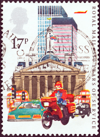UNITED KINGDOM - CIRCA 1983  A stamp printed in United Kingdom issued for the 350 Years of Royal Mail Public Postal Service shows Datapost Motorcyclist, City of London, circa 1983