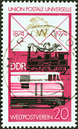 upu: GERMAN DEMOCRATIC REPUBLIC - CIRCA 1974  A stamp printed in Germany from the  Centenary of U P U  issue shows Steam and diesel railway locomotives, circa 1974   Editorial