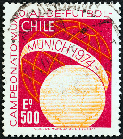 west of germany: CHILE - CIRCA 1974  A stamp printed in Chile from the  World Cup Football Championships, West Germany   issue shows ball and Globe, circa 1974   Editorial