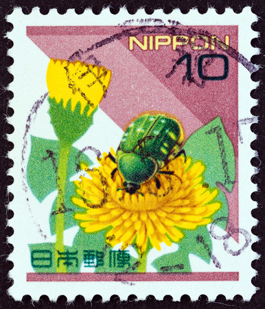 smaller: JAPAN - CIRCA 1997  A stamp printed in Japan shows a Smaller Green Flower Chafer  Oxycetonia jucunda  beetle, circa 1997