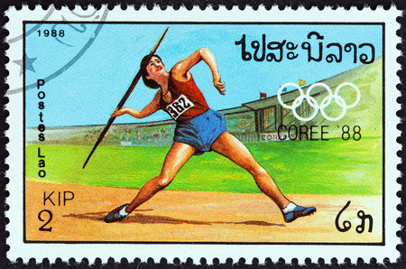 javelin throw: LAOS - CIRCA 1988  A stamp printed in Laos from the  Olympic Games, Seoul   2nd issue shows Javelin throw, circa 1988
