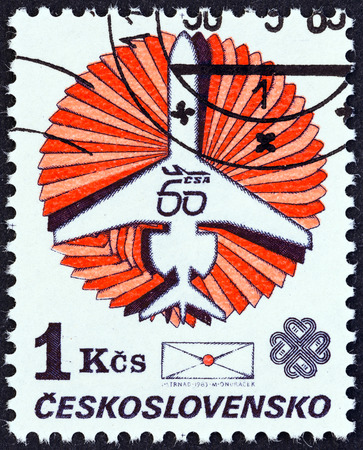 CZECHOSLOVAKIA - CIRCA 1983  A stamp printed in Czechoslovakia issued for the World Communications Year and 60th anniversary of Czechoslovak Airlines shows Ilyushin Il-62 and envelope, circa 1983
