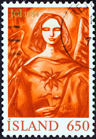 ICELAND - CIRCA 1984  A stamp printed in Iceland from the  Christmas   issue shows Angel with Christmas rose, circa 1984