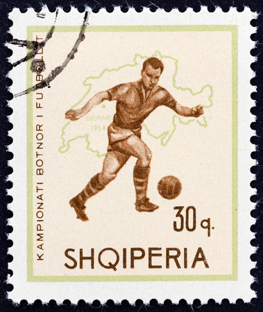 ALBANIA - CIRCA 1966  A stamp printed in Albania from the  Football World Cup - England   issue shows soccer player and map of Switzerland  1954 , circa 1966