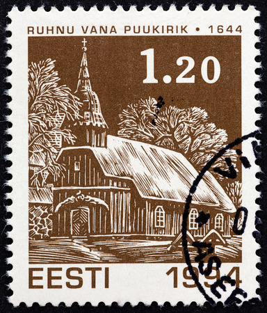 ESTONIA - CIRCA 1994  A stamp printed in Estonia from the  Christmas   issue shows Old Ruhnu wooden church  1644 , circa 1994