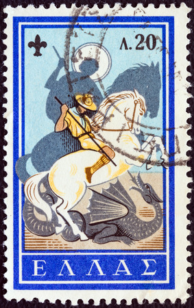 slaying: GREECE - CIRCA 1960  A stamp printed in Greece from the  50th anniversary of Greek Boy Scout Movement  issue shows boy scout and St  George slaying the dragon, circa 1960
