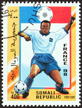 somali: SOMALIA - CIRCA 1997  A stamp printed in Somalia from the  Football World Cup - France   issue shows football player, circa 1997   Editorial