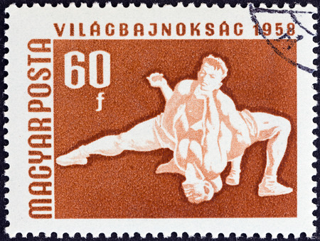 magyar: HUNGARY - CIRCA 1958  A stamp printed in Hungary from the  European Table Tennis, Swimming and World Wrestling Championships, Budapest  issue shows wrestlers , circa 1958