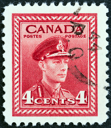 postes: CANADA - CIRCA 1942  A stamp printed in Canada from the  War Effort  issue shows King George VI in Military Uniform, circa 1942