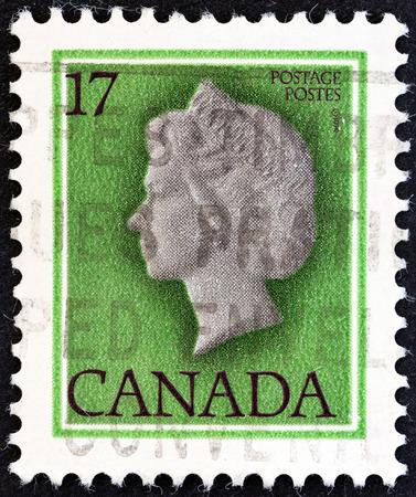 canada stamp: CANADA - CIRCA 1979  A stamp printed in Canada shows Queen Elizabeth II, circa 1979   Editorial