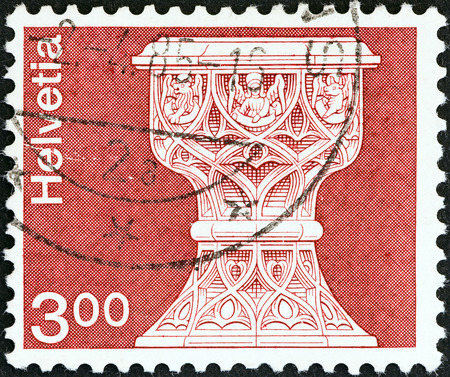 confederation: SWITZERLAND - CIRCA 1973  A stamp printed in Switzerland shows font, St  Maurice church, Saanen, circa 1973   Editorial