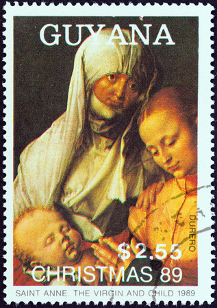 albrecht: GUYANA - CIRCA 1989  A stamp printed in Guyana from the  Christmas  Paintings  issue shows Saint Anne, The Virgin and Child  Albrecht Durer , circa 1989   Editorial