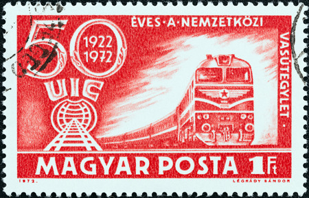 magyar: HUNGARY - CIRCA 1972  A stamp printed in Hungary issued for the 50th anniversary of International Railway Union shows Class M62 Diesel Train and U I C  Emblem, circa 1972