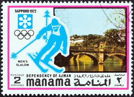 dependency: MANAMA DEPENDENCY - CIRCA 1971  A stamp printed in United Arab Emirates from the  1972 Winter Olympic Games - Sapporo, Japan  issue shows Men s slalom, circa 1971