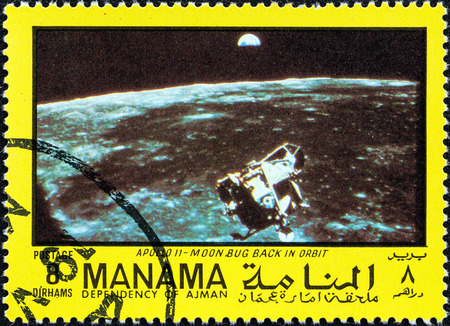 sello: MANAMA DEPENDENCY - CIRCA 1970  A stamp printed in United Arab Emirates from the  Space exploration  issue shows Apollo 11, Moon bug back in orbit, circa 1970   Editorial