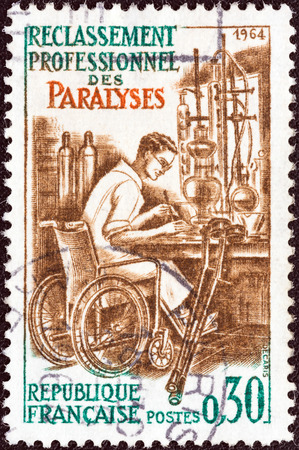 postes: FRANCE - CIRCA 1964  A stamp printed in France from the  Professional Rehabilitation of Paralytics  issue shows Paralytic at Work in Invalid Chair, circa 1964