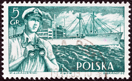 merchant: POLAND - CIRCA 1956  A stamp printed in Poland from the  Merchant Navy  issue shows merchant navy officer and Kilinski  freighter , circa 1956