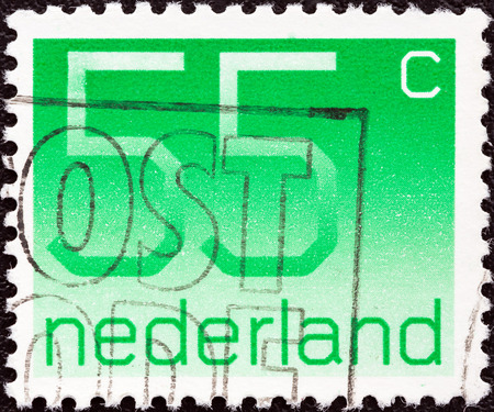 orange nassau: NETHERLANDS - CIRCA 1976  A stamp printed in the Netherlands shows numeral ordinary gum, circa 1976   Editorial