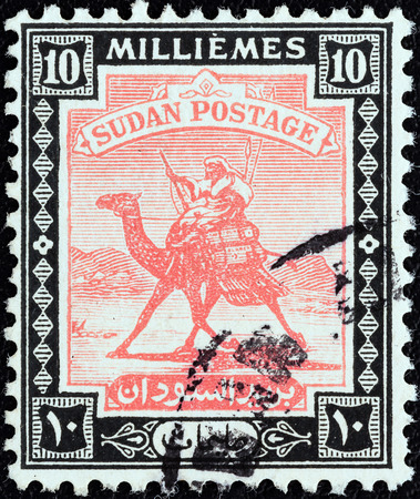 postman of the desert: SUDAN - CIRCA 1921  A stamp printed in Sudan shows Arab Postman on camel, circa 1921