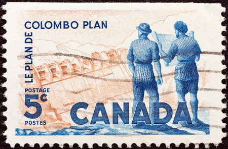 canada stamp: CANADA - CIRCA 1961  A stamp printed in Canada from the  Colombo Plan  issue shows Engineers and Dam, circa 1961   Editorial