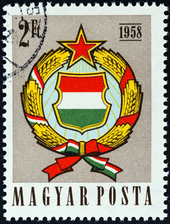 magyar: HUNGARY - CIRCA 1958  A stamp printed in Hungary issued for the 1st anniversary of Amended Constitution shows Arms of Hungary, circa 1958