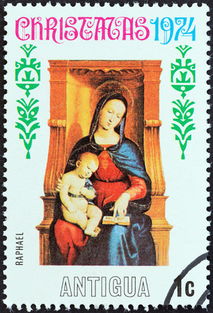 ANTIGUA - CIRCA 1974  A stamp printed in Antigua from the  Christmas   issue shows Madonna and Child by Raphael, circa 1974