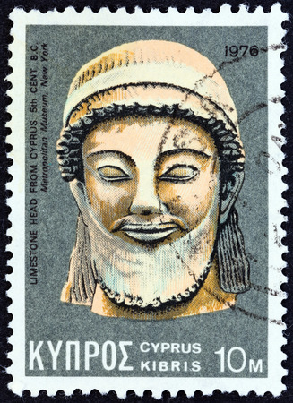 kypros: CYPRUS - CIRCA 1976  A stamp printed in Cyprus shows a limestone head from 5th century BC found in Cyprus and now exposed in in Metropolitan museum New York, circa 1976