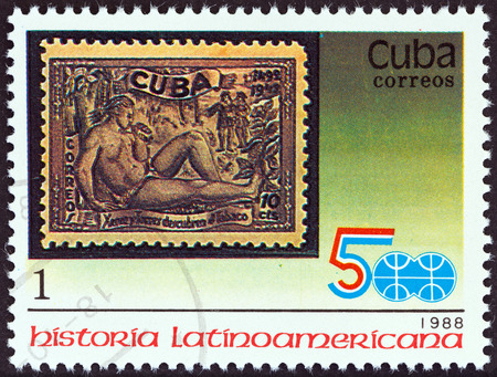 CUBA - CIRCA 1988  A stamp printed in Cuba from the  Latin American History  3rd series   issue shows 1944 10c  Discovery of Tobacco stamp, circa 1988