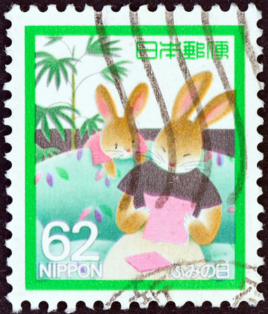 JAPAN - CIRCA 1989  A stamp printed in Japan issued for the letter writing day shows Mother Rabbit reading letter, circa 1989