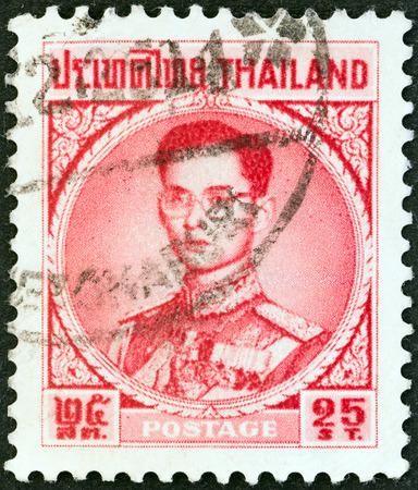 THAILAND - CIRCA 1963  A stamp printed in Thailand shows King Bhumibol Adulyadej, circa 1963