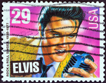 postage stamp: USA - CIRCA 1993  A stamp printed in USA from the  American Music Series  issue shows Elvis Presley  rock   roll singer and actor , circa 1993   Editorial
