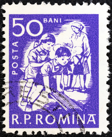 stempeln: ROMANIA - CIRCA 1960  A stamp printed in Romania shows children at play, circa 1960