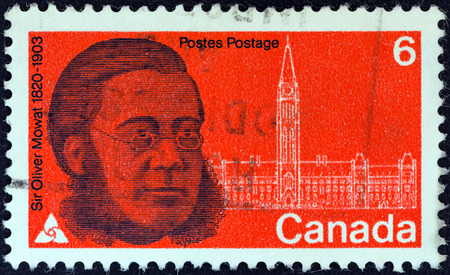 statesman: CANADA - CIRCA 1970  A stamp printed in Canada issued for the 150th anniversary of his birth shows statesman Sir Oliver Mowat and Parliament, circa 1970