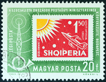 timbre: HUNGARY - CIRCA 1963  A stamp printed in Hungary from the  Organization of Socialist Countries Postal Administrations Conference, Budapest  issue shows an Albanian stamp of 1962, circa 1963