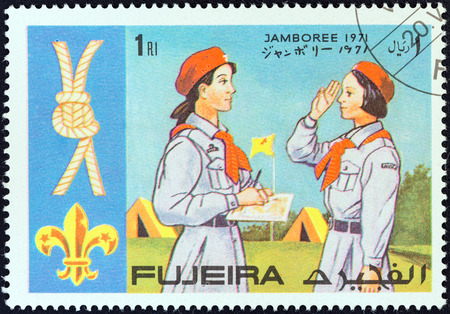 FUJAIRAH EMIRATE - CIRCA 1971  A stamp printed in United Arab Emirates from the  World boy scout jamboree  issue shows scouts and knot, circa 1971