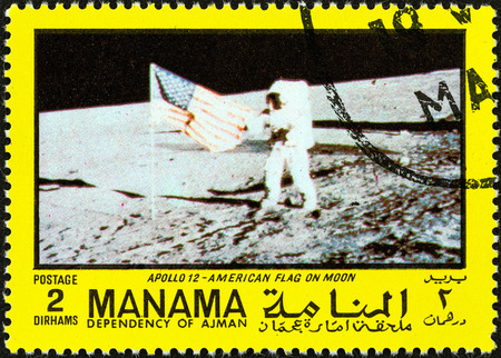 dependency: MANAMA DEPENDENCY - CIRCA 1970  A stamp printed in United Arab Emirates from the  Space exploration  issue shows U S  flag on the moon, circa 1970