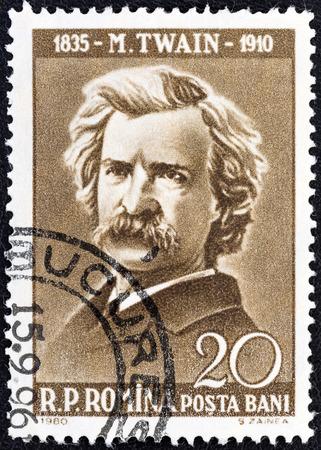 twain: ROMANIA - CIRCA 1960  A stamp printed in Romania from the  Cultural Anniversaries  issue shows Mark Twain  writer, 50th death anniversary , circa 1960