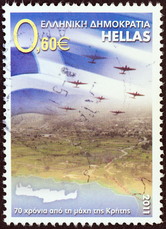 GREECE - CIRCA 2011  A stamp printed in Greece issued for the 70th anniversary of the Battle of Crete shows Greek flag and airplanes over Crete, circa 2011
