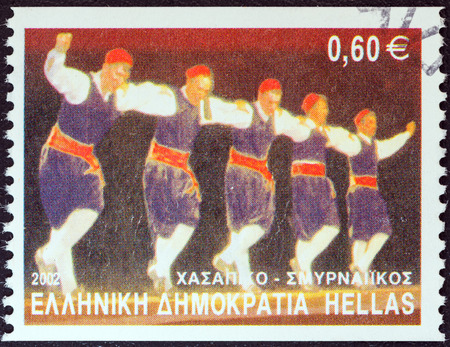 smyrna: GREECE - CIRCA 2002  A stamp printed in Greece from the  Greek Dances  issue shows Hassapiko dance, Smyrna, circa 2002   Editorial