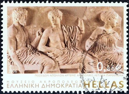 pediment: GREECE - CIRCA 2006  A stamp printed in Greece from the  Greek Museums  issue shows gods Poseidon, Apollo and Artemis, East Parthenon Pediment  The Acropolis Museum , circa 2006