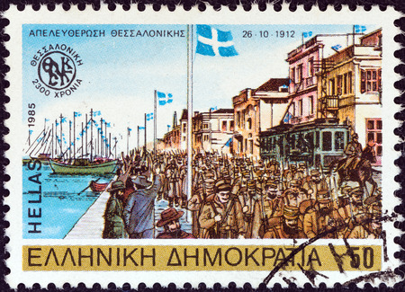 liberating: GREECE - CIRCA 1985  A stamp printed in Greece from the  2300th anniversary of Thessaloniki city  issue shows Greek army liberating Thessaloniki, 1912, circa 1985