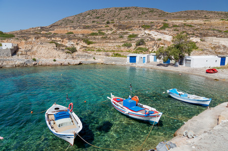 Traditional fishing boats in Ag  Nikolas bay, Kimolos island, Cyclades, Greece photo
