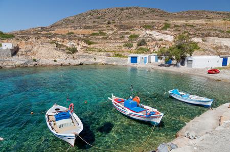 Traditional fishing boats in Ag  Nikolas bay, Kimolos island, Cyclades, Greece photo