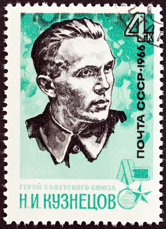 timbre: USSR - CIRCA 1966: A stamp printed in USSR from the War Heroes. Guerrilla Fighters  issue shows N. I. Kuznetsov (1911-1944), circa 1966.