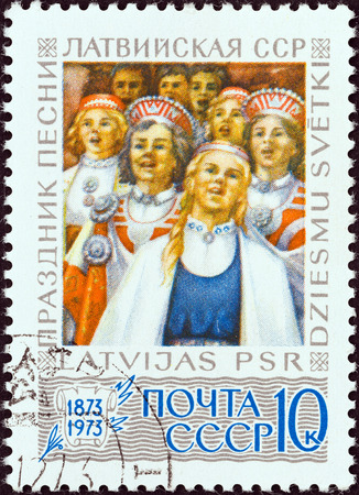 latvia girls: USSR - CIRCA 1973: A stamp printed in USSR issued for the Centenary of Latvian Singing Festival shows Girls\
