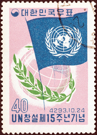 un used: SOUTH KOREA - CIRCA 1960: A stamp printed in South Korea issued for the 15th anniversary of United Nations shows UN Flag, Globe and Laurel, circa 1960.